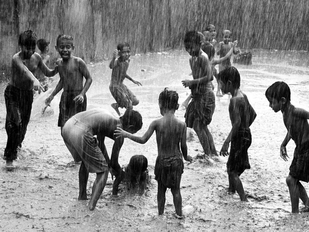 Children Play in rain India